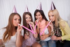Four attractive females celebrating Stock Images