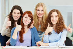 Women holding thumbs up Stock Images