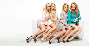 Four attractive ladies posing together Stock Photography