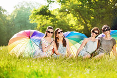 Four attractive ladies sitting on the fresh lawn Royalty Free Stock Photography