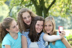 Four attractive teenage girls in a park Stock Photos