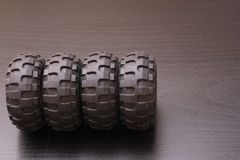 Car rubbers. Four auto wheels rubbers on a gray background Stock Photos