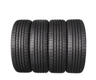 Four automobile black rubber tires isolated on white Royalty Free Stock Photos