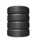Four automobile black rubber tires on white Stock Photo