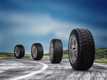 Four automobile wheels on the road. 3d render. Four automobile wheel on the road. 3d rendering Stock Image