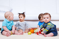 Four babies group Stock Photo