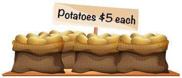 Four bags of fresh potatoes Stock Photos