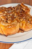Homemade, hot baked Pecan sticky buns Royalty Free Stock Images