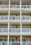 Four Balconies with White Railings Royalty Free Stock Images