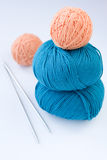 Four ball of yarn for knitting and needles Stock Image