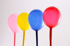 Four baloons. Pink, yellow, blue and red baloons Royalty Free Stock Photos