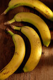 Four bananas on the table Royalty Free Stock Photo