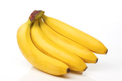 Four bananas on white Royalty Free Stock Images