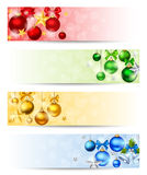 Four banners with colorful Christmas balls. Vector eps-10. Vector set of four Christmas banners with red, yellow, green and blue balls, stars and sparkles Royalty Free Stock Image