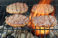 Four barbecue hamburgers Stock Photography