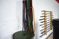 Four Barbells. In Gym Background stock image