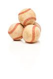 Four Baseballs Isolated on Reflective White Stock Photography