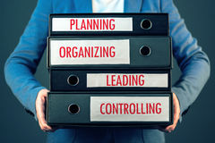 Four basic functions of management process in business organization. Planning, organizing, leading and controlling stock images