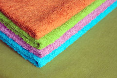 Four bath towels of different colors stacked closeup Royalty Free Stock Photos