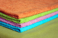 Four bath towels of different colors stacked closeup Royalty Free Stock Image