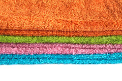 Four bath towels of different colors stacked isolated Royalty Free Stock Photography
