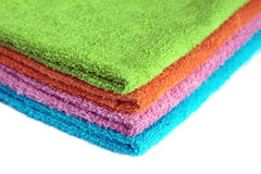 Four bath towels of different colors stacked isolated Royalty Free Stock Image