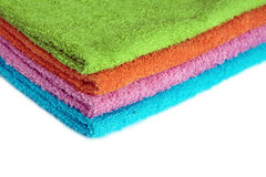 Four bath towels of different colors stacked isolated Stock Photo