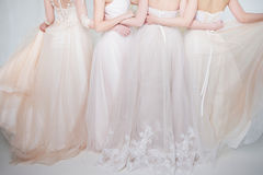 Four Beautiful Bridesmaid Dresses In Pastel Colors Are In Each Other`s Arms. Back, Close-up Lace Skirts Stock Photography