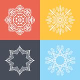 Four beautiful circular ornament on a colored background. Mandala. Stylized flowers. Islam, Arabic, Indian, ottoman motifs. Stock Photos