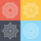 Four beautiful circular ornament on a colored background. Mandala. Stylized flowers. Islam, Arabic, Indian, ottoman motifs. Royalty Free Stock Photography