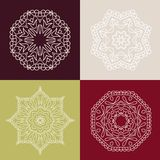 Four beautiful circular ornament on a colored background. Mandala. Stylized flowers. Vintage decorative elements. Stock Images