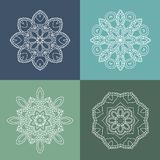 Four beautiful circular ornament on a colored background. Mandala. Stylized flowers. Vintage decorative elements. Stock Image