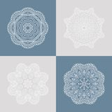 Four beautiful circular ornament on a colored background. Mandala. Stylized flowers. Vintage decorative elements. Royalty Free Stock Photography