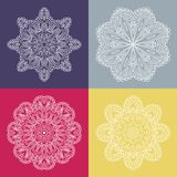 Four beautiful circular ornament on a colored background. Mandala. Stylized flowers. Vintage decorative elements. Stock Photo