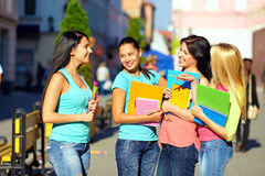 Four beautiful college girls talking on the street Royalty Free Stock Photography