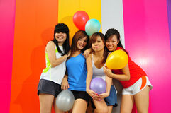 Four Beautiful Girlfriends posing with balloons Stock Images