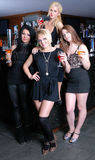 Four beautiful girls in bar Stock Images