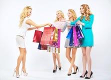 Four beautiful girls enjoying the shopping royalty free stock photography