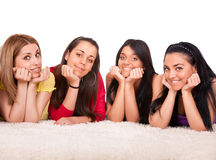 Four beautiful girls on the floor Royalty Free Stock Photography