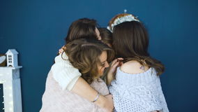 Four beautiful girls hug each other . Girlfriends having fun and laugh in bedroom stock footage