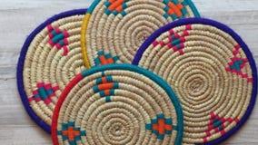 Northern Iran handicraft. Four Beautiful Handmade Woven Bamboo / Cane Trays. Four Beautiful Handmade Woven Bamboo / Cane Trays with Colourful Woollen Elements stock image
