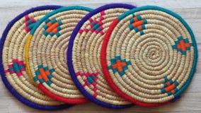 Northern Iran handicraft. Four Beautiful Handmade Woven Bamboo / Cane Trays. Four Beautiful Handmade Woven Bamboo / Cane Trays with Colourful Woollen Elements royalty free stock photo