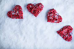 Four beautiful romantic vintage hearts on a white frosty snow background. Love and St. Valentines Day concept Royalty Free Stock Photos