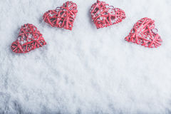 Four beautiful romantic vintage hearts on a white frosty snow background. Love and St. Valentines Day concept. Stock Photos