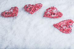 Four beautiful romantic vintage hearts on a white frosty snow background. Love and St. Valentines Day concept. Stock Image