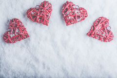 Four beautiful romantic vintage hearts on a white frosty snow background. Love and St. Valentines Day concept. Royalty Free Stock Photo