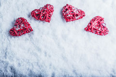 Four beautiful romantic vintage hearts on a white frosty snow background. Love and St. Valentines Day concept. Stock Photography