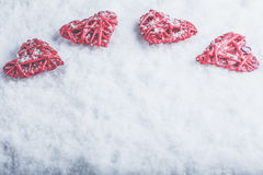 Four beautiful romantic vintage hearts on a white frosty snow background. Love and St. Valentines Day concept. Royalty Free Stock Photos