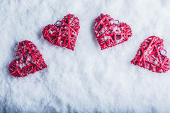 Four beautiful romantic vintage hearts on a white frosty snow background. Love and St. Valentines Day concept. Stock Images