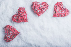Four beautiful romantic vintage hearts on a white frosty snow background. Love and St. Valentines Day concept. Stock Photo